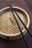 Bamboo steamer with chopsticks