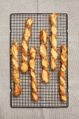 Cheese sticks on a wire rack