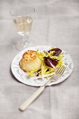 Savoury pudding with salad leaves