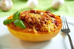 Spaghetti squash filled with tomato sauce and mushrooms, topped with cheese and baked