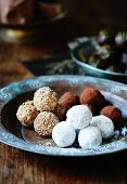 Assorted chocolate truffles on a metal plate