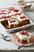 Spiced tray bake with light icing and cranberries