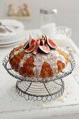 Orange cake with fresh figs and icing sugar