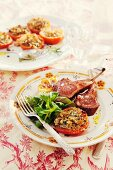 Lamb chops with stuffed tomatoes à la provençale served with lambs lettuce