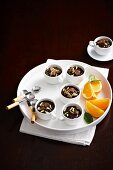 Chocolate mousse with orange liqueur in coffee cups