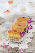 Samolina cake on a silver tray with flowers