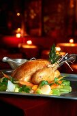 Roast chicken with herbs and spring vegetables
