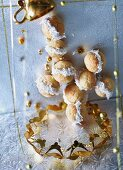 Coconut balls with gold Christmas decorations