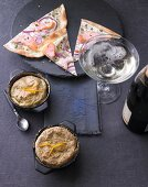 Tarte flambée with herby sour cream and broccoli soufflés with orange zest, with a glass of champagne