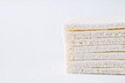 Crustless slices of white bread, stacked