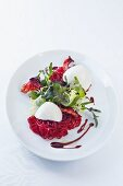 Quenelles of horseradish mousse on beetroot vermicelli
