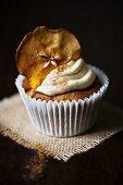 Single cupcake with apple crisp and sprinkle of cinnamon
