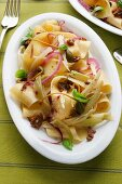 Pappardelle pasta with fennels and olives, Italy