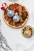 Dried fruit, cinnamon sticks, star anise and Christmas tree baubles