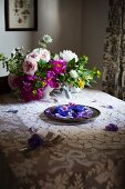 Edible Flowers on a Platter set on a Table; Cornflower, Violas and Pansies