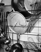 Kitchen accessories and utensils hanging on the wall