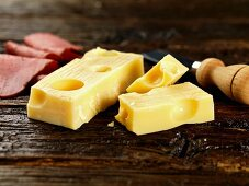 Emmental and ham on a wooden surface
