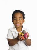 A Boy with a Handful of Raw Potatoes
