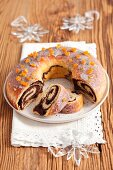 Poppyseed roulade, partly sliced (for Christmas)