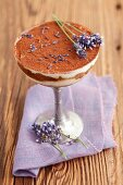 A layered dessert with Lebkuchen (spiced soft gingerbread from Germany), mascarpone and lavender flowers