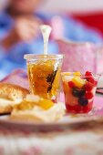 Scones with citron marmalade and fruit salad, for tea
