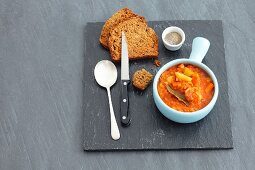 Vegetable stew with lentils and tomatoes, in cups with soda bread