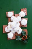Almond biscuits dusted with icing sugar for Christmas