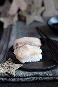 Nigiri sushi with bream (tai) and Christmas stars made from birch bark