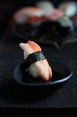 Sushi with crab being dipped in soy sauce