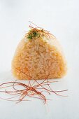 Onigiri (spiced rice ball, Japan) with peppers and salmon