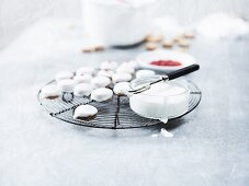Pfeffernüsse (spiced soft gingerbread from Germany) with icing on a wire rack