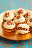 Walnut meringues with chocolate filling, for Christmas