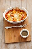 Spaghetti with turkey meatballs and tomato sauce, topped with cheese and baked
