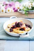 Baked bananas with blackberry sauce