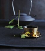 Blackcurrant tea in a golden cup