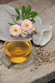 Aromatised women's tea next hot water bottle on a wooden table