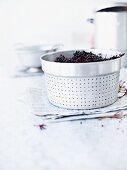 Elderberries in a colander insert