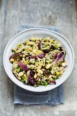 Rice with colourful lentils and red onions