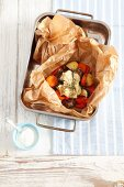 Kleftiko with pork, vegetables and ewe's cheese, in baking parchment