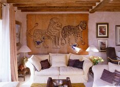 A bright living room in an English country house with a sofa and hand-knotted wall hanging from China