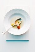 A plate with the remains of soup