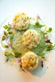 Zander fishcakes on a herb sauce