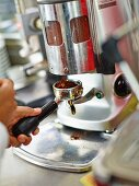 Coffee being ground for espresso