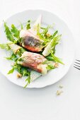 Goat's cheese saltimbocca on rocket salad with pear and walnuts