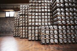 Kegs of beer in storage at a commercial brewery
