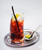 Cuba Libre cocktail on a silver tray