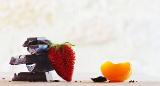Chocolate, a strawberry and a wedge of orange