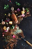 Crispy potato base with a Lamb role, mushrooms, red onion and edible flowers