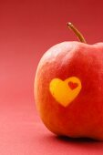 Red apple with heart