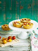 Savoury pastry tartlets with cheddar and tomatoes